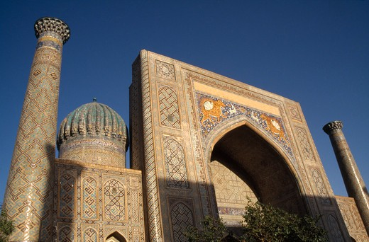 Stock Photo: 1850-4539 Uzbekistan , Samarkand, Registan , 'Shir Dor Madrassah, Detail Of The Decorated Arch, Dome And Tower Of The Muslim College Partially Cast In Shadow'