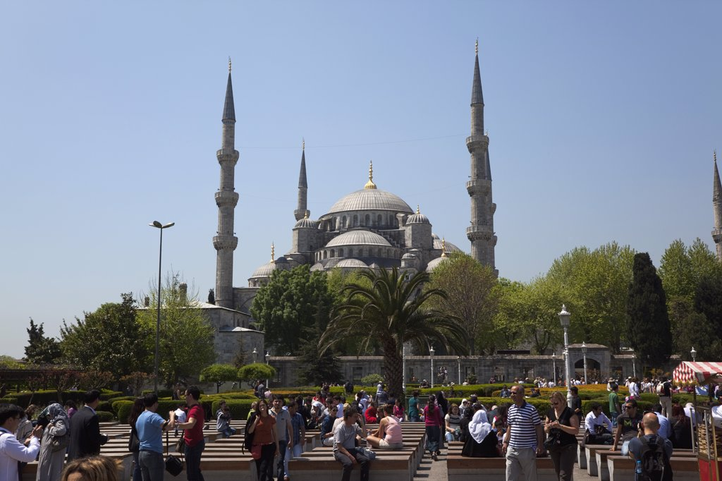 Stock Photo: 1850-45408 Sultanahmet Camii Blue Mosque with tourists sat outside.Turkey Istanbul