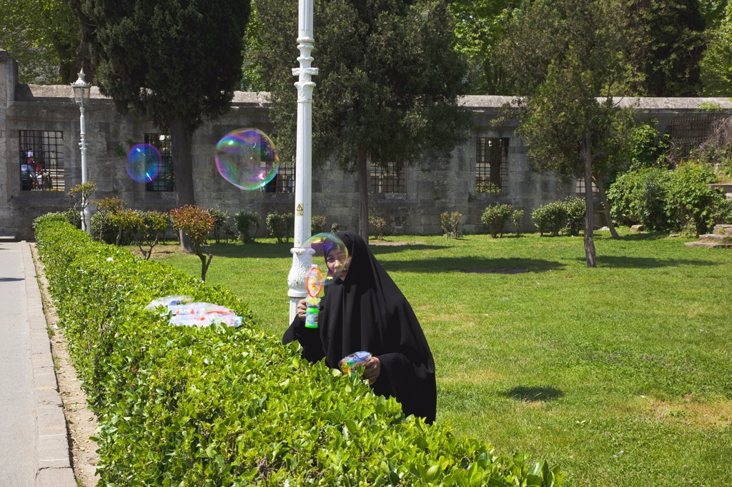 Istanbul Sultanahmet woman selling bubble gun machine in park outside the Blue Mosque.Turkey Istanbul : Stock Photo
