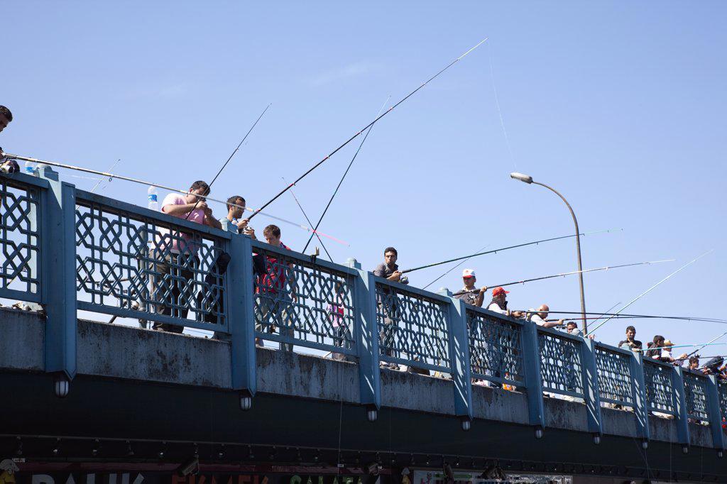 Stock Photo: 1850-45490 Galata Bridge people fishing.Turkey Istanbul