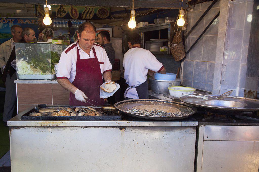 Stock Photo: 1850-45513 Karakoy Galata fish market stall selling fried fish snacks.Turkey Istanbul