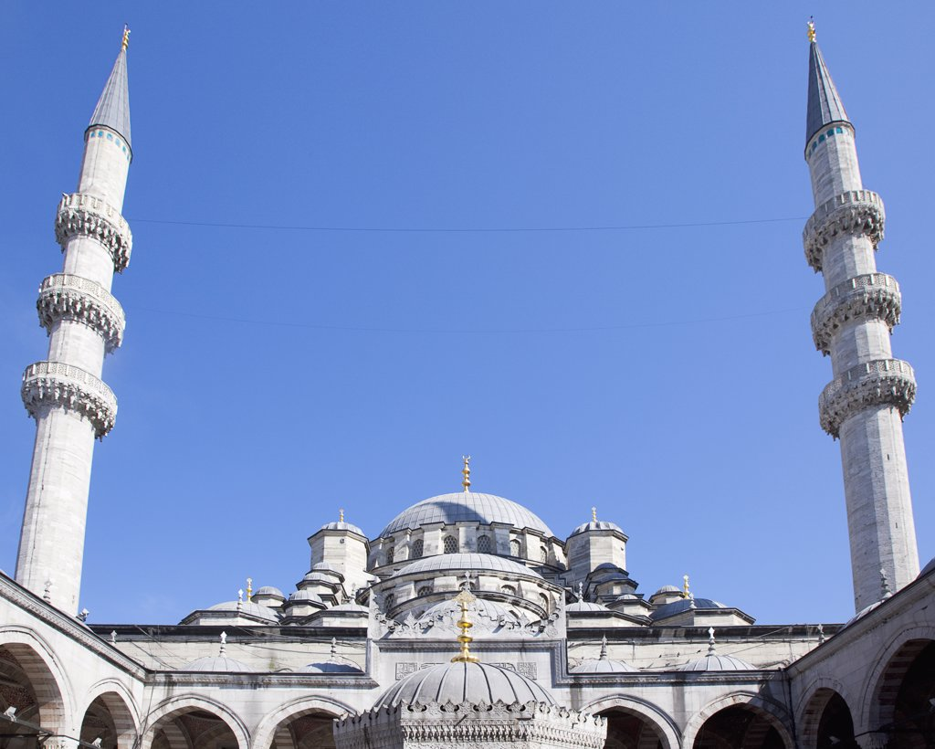 Stock Photo: 1850-45527 Eminonu Yeni Camii New Mosque Domed roof and Minarets.Turkey Istanbul