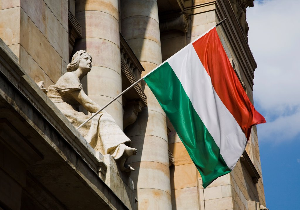 Stock Photo: 1850-45577 Hungary, Budapest, Hungarian Flag flying with Art Nouveau facade behind  in central Pest.