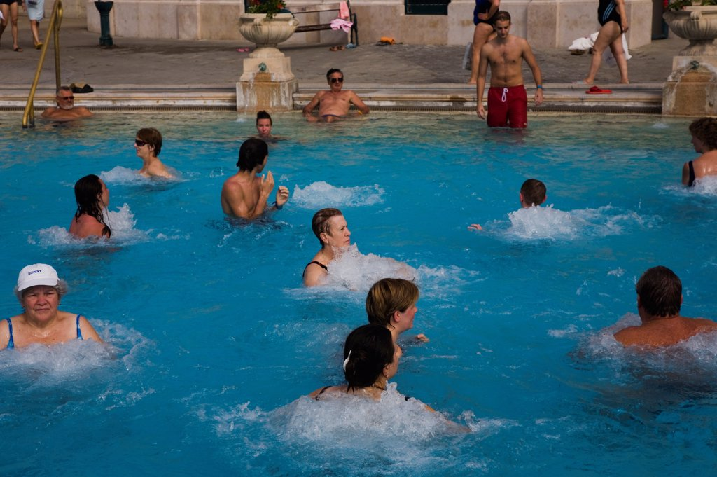 Stock Photo: 1850-45586 Hungary, Budapest, Pest, Mixed group outdoor bathing in summer at Szechenyi thermal baths, largest in Europe.
