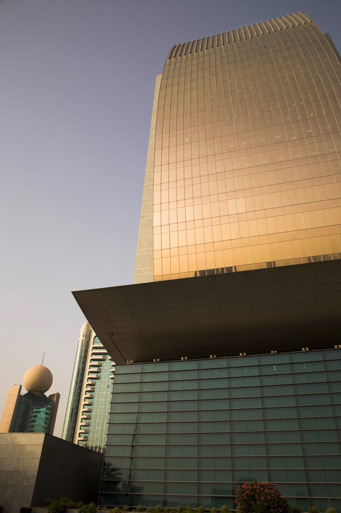 Stock Photo: 1850-45617 UAE , Dubai,  Curved glass facade of National Bank of Dubai building with Etisalat tower behind