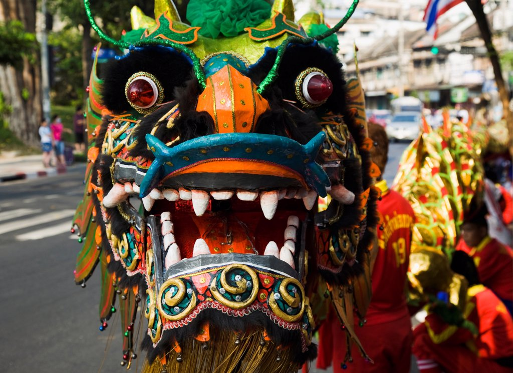 Stock Photo: 1850-45643 Thailand, Bangkok, Dragon Dance head carried in parade celebrating local temple on New Road , first paved road in the city.