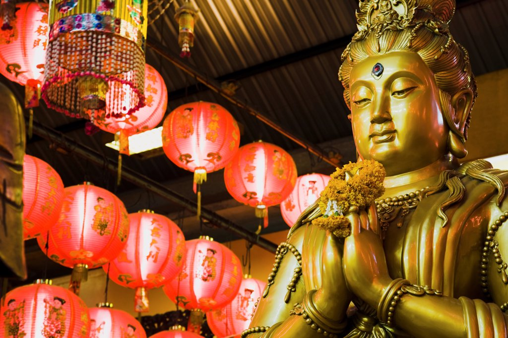 Stock Photo: 1850-45685 Thailand, Bangkok, Gold Guanyin Goddess of Mercy statue with red lanterns for Chinese New Year.