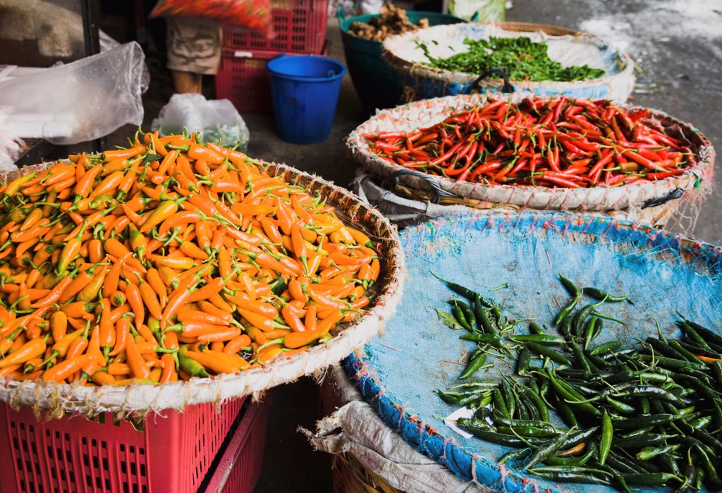 Thailand, Bangkok, Red, green and yellow chilis in Chinatown market. : Stock Photo