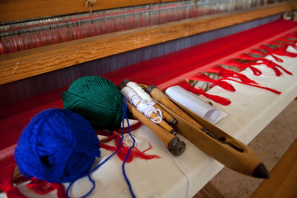 Stock Photo: 1850-45830 Greece, Ioannina, Zagorohoria, Close of an old traditional loom with balls of wool and tools.