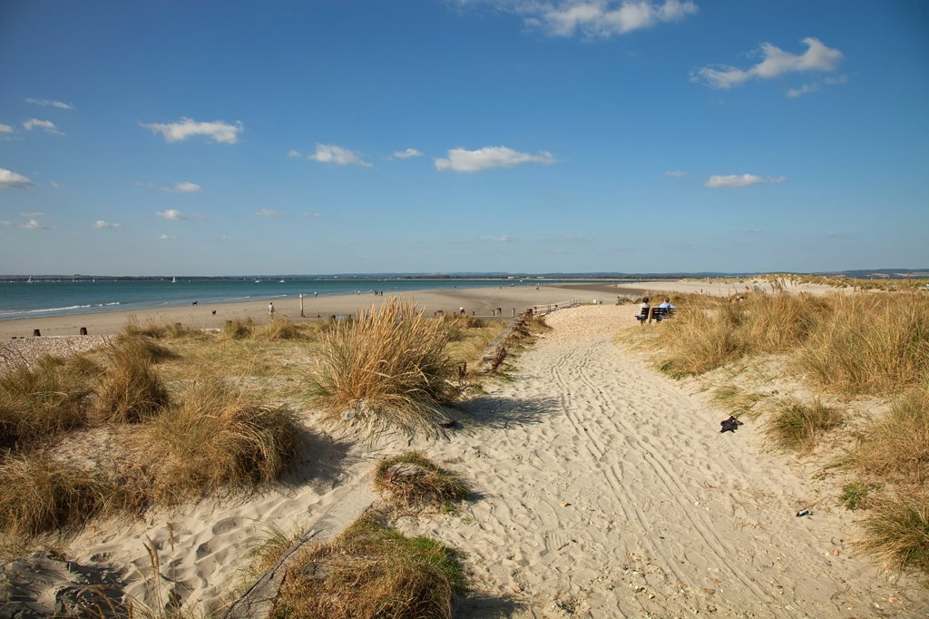 Stock Photo: 1850-45869 England, West Sussex, West Wittering Beach, View across sand dunes towards beach and sea at East Head. Sunshine and blue sky.
