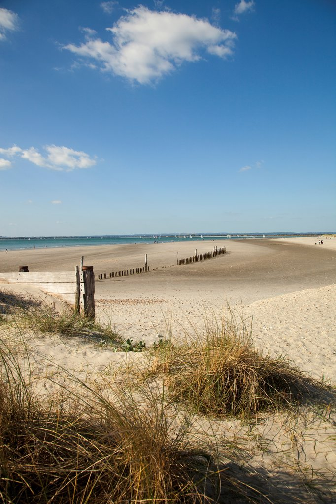 Stock Photo: 1850-45870 England, West Sussex, West Wittering Beach, View across sand dunes towards beach and sea at East Head. Sunshine and blue sky.