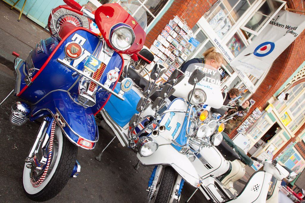 Stock Photo: 1850-45932 England, East Sussex, Brighton, Elaborately decorated Mopeds on Madeira Drive during motorbike festival.