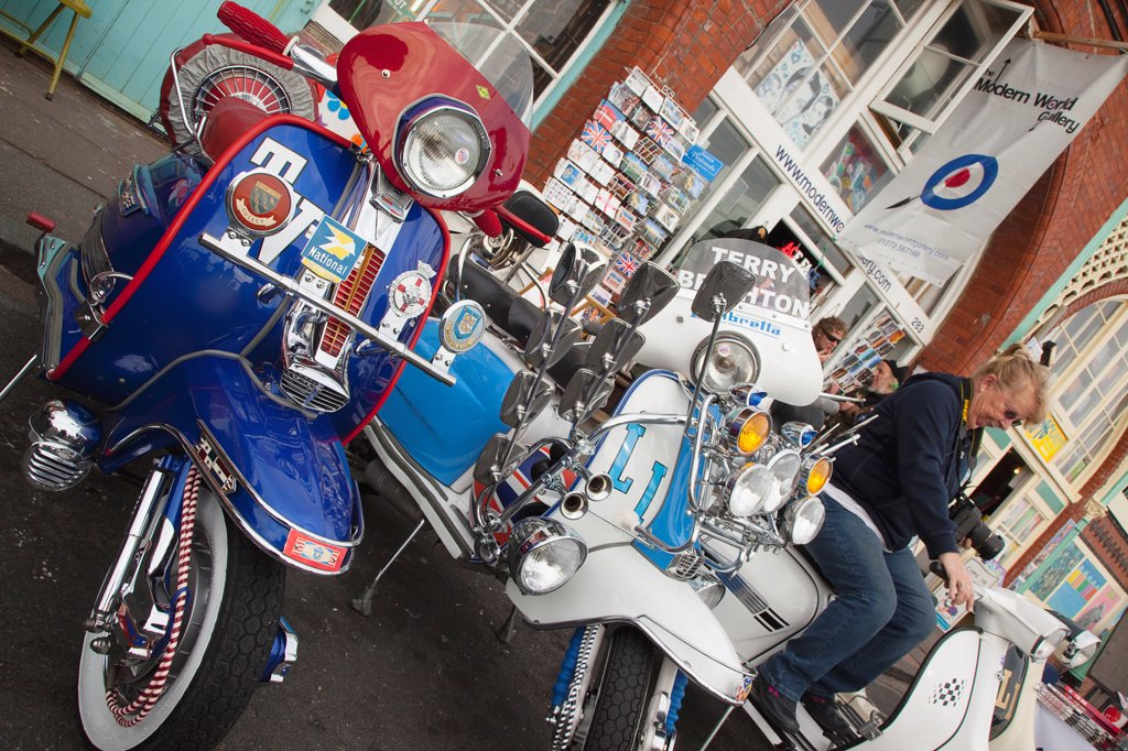 England, East Sussex, Brighton, Elaborately decorated Mopeds on Madeira Drive during motorbike festival. : Stock Photo