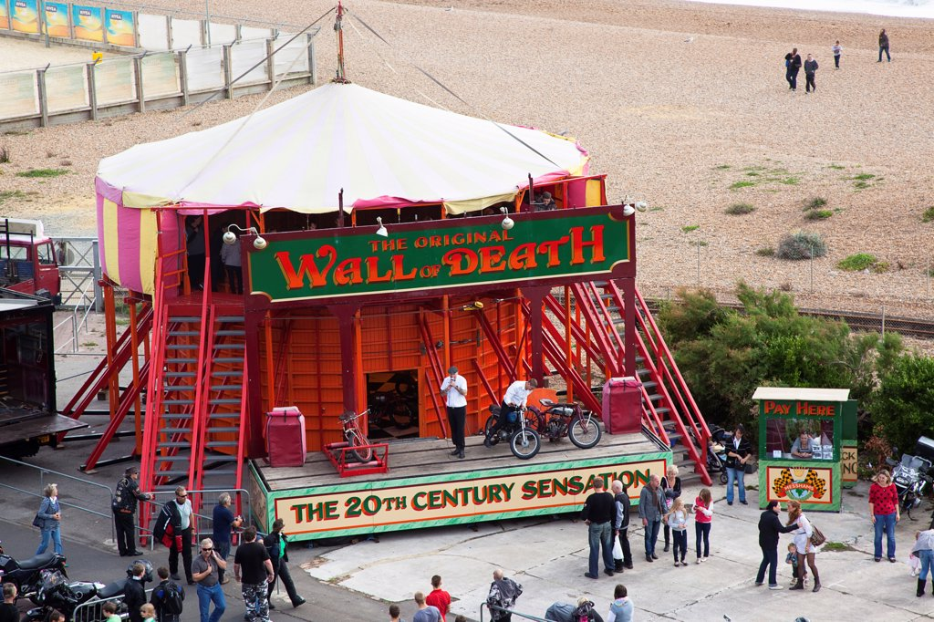 England, East Sussex, Brighton, Wall of death motorcycle fairground attraction on Madeira Drive during motorbike festival. : Stock Photo