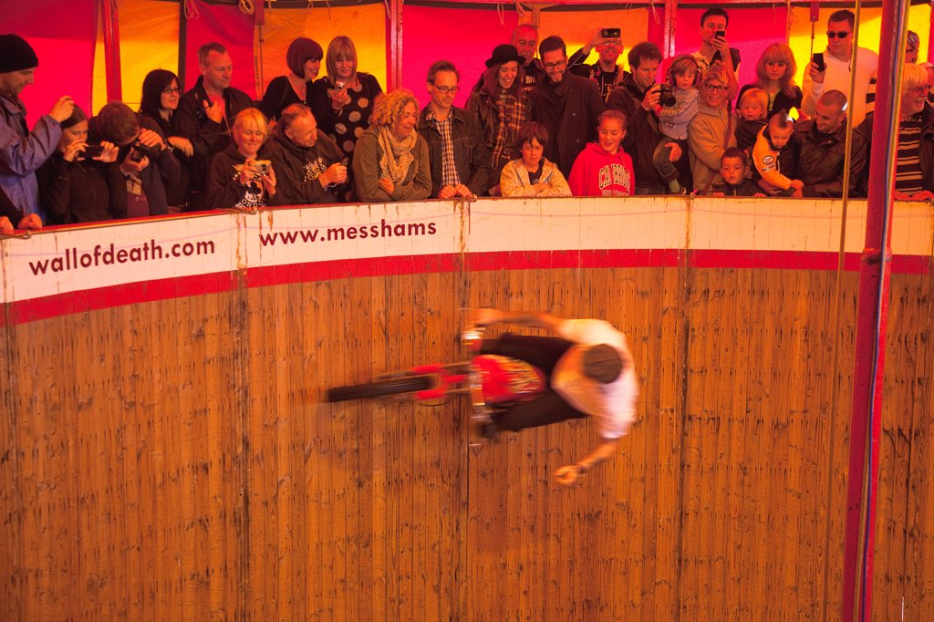 Stock Photo: 1850-45953 England, East Sussex, Brighton, Wall of death motorcycle fairground attraction on Madeira Drive during motorbike festival.