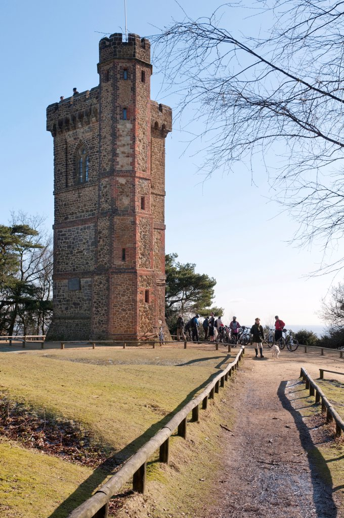 England, Surrey, Dorking, Leith Tower with walkers in mid winter. : Stock Photo