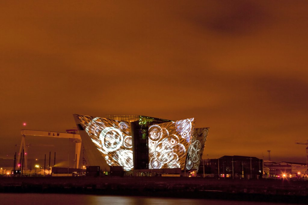 Stock Photo: 1850-46085 Ireland, North, Belfast, Titanic Quarter, Visitor centre designed by Civic Arts & Eric R Kuhne, illuminated at night.