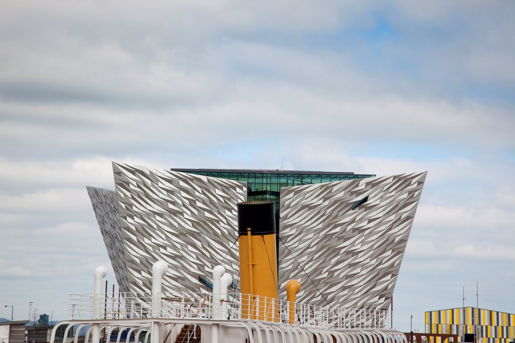 Stock Photo: 1850-46124 Ireland, North, Belfast, Titanic Quarter, Visitor centre designed by Civic Arts & Eric R Kuhne, with funnel of SS Nomadic in the foreground.