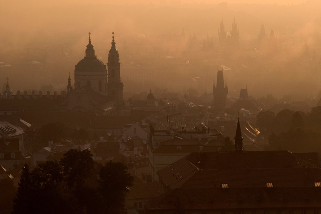 Czech Republic, Bohemia, Prague, Post dawn fog over the city with St Nicholas Cathedral in foreground. : Stock Photo