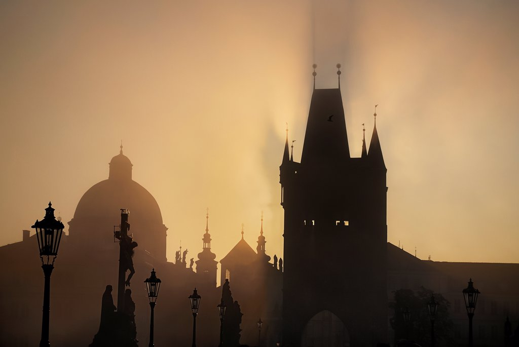 Czech Republic, Bohemia, Prague, The Calvary statue in early morning mist on Charles Bridge : Stock Photo