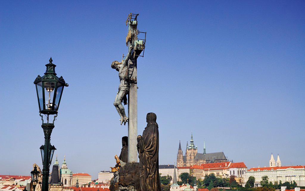 Czech Republic, Bohemia, Prague, Charles Bridge, Calvary with St Vitus in the background. : Stock Photo