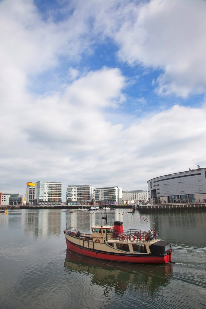 Stock Photo: 1850-46238 Ireland, North, Belfast, Titanic Quarter, tour boat taking tourists on sightseeing cruise.