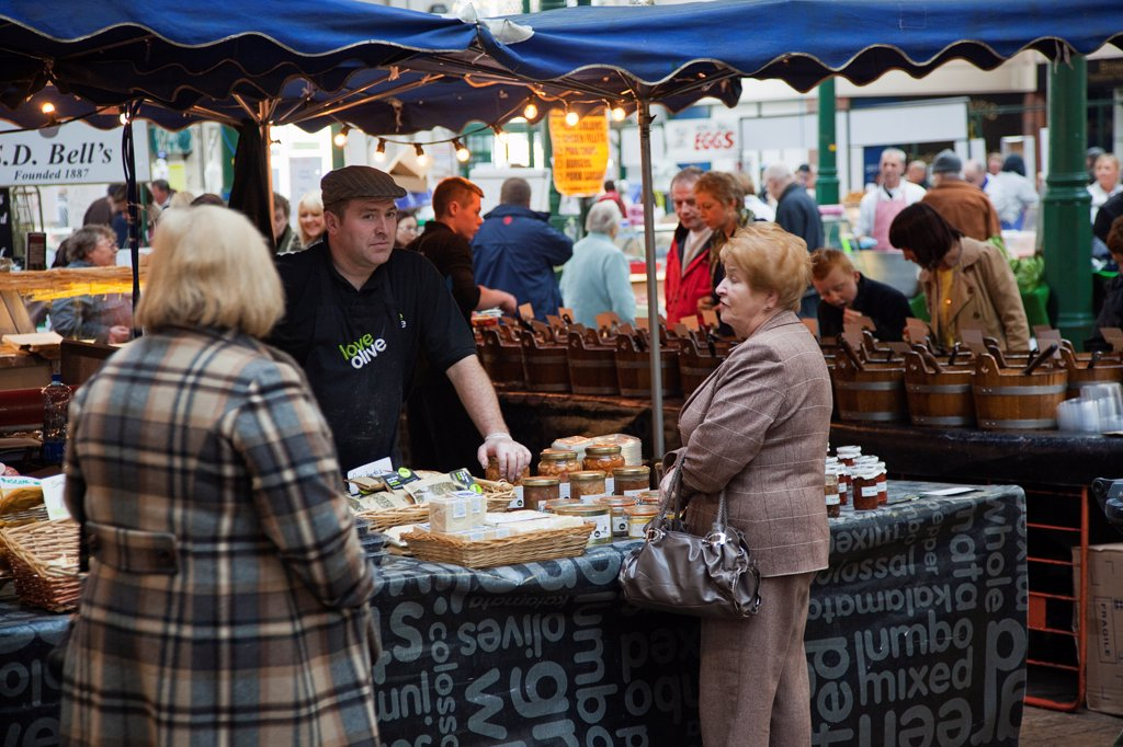 Stock Photo: 1850-46260 Ireland, North, Belfast, St Georges Market, stall selling, olives, cheese and preserves.