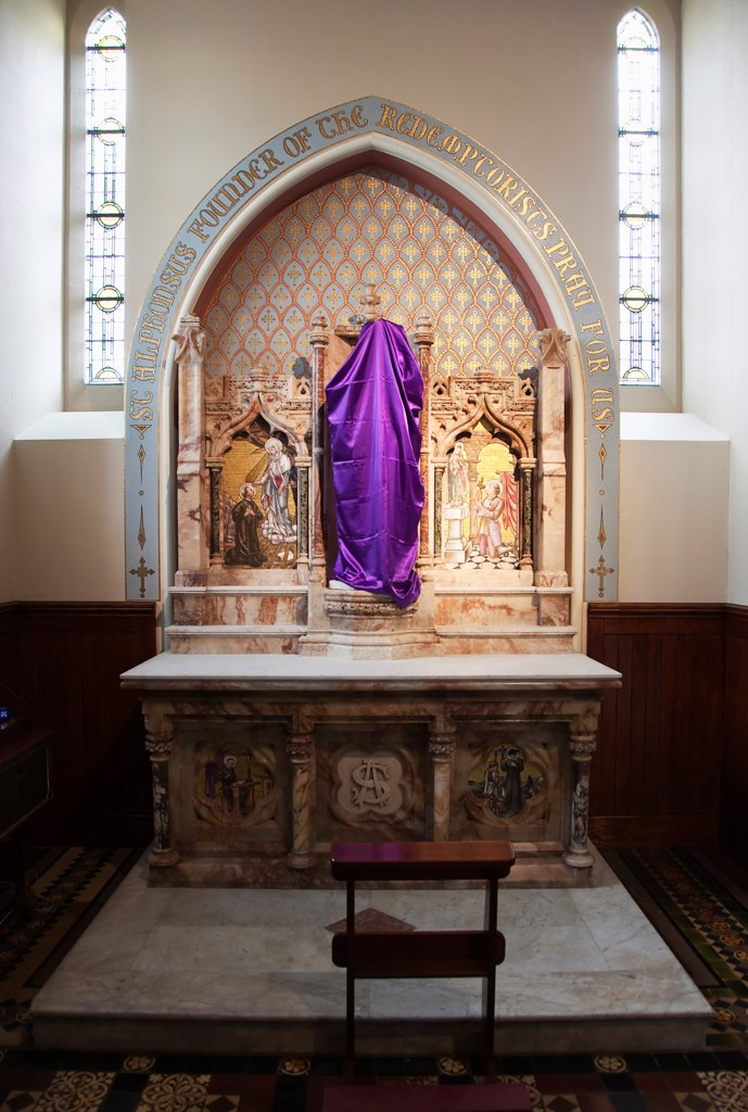 Ireland, North, Belfast, Falls Road, Clonard Monastery interior decorated for Good Friday with statues draped in purple cloth. : Stock Photo