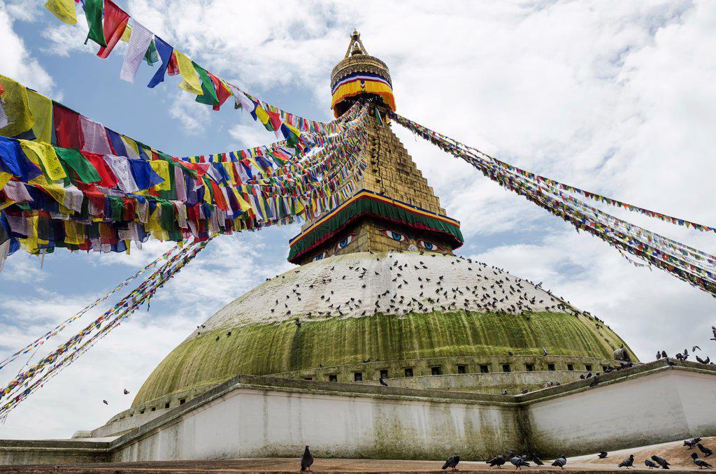 Nepal, Boudhanath Stupa near Kathmandu, with coloutful prayer flags. : Stock Photo