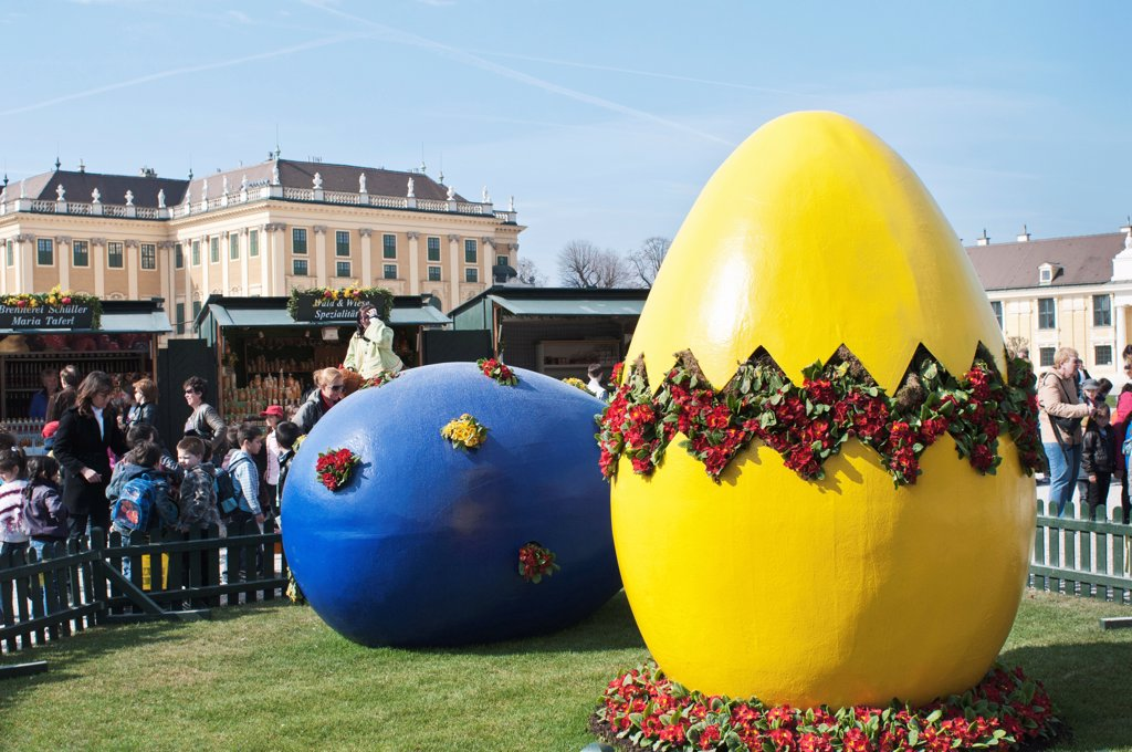 Austria, Vienna, Giant painted Easter eggs at entrance of the Easter Market at the Schonbrunn Palace. : Stock Photo