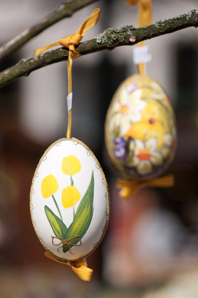Stock Photo: 1850-46373 Austria, Vienna, Hand-painted egg shells hanging from a branch to celebrate Easter at the Old Vienna Easter Market at the Freyung.