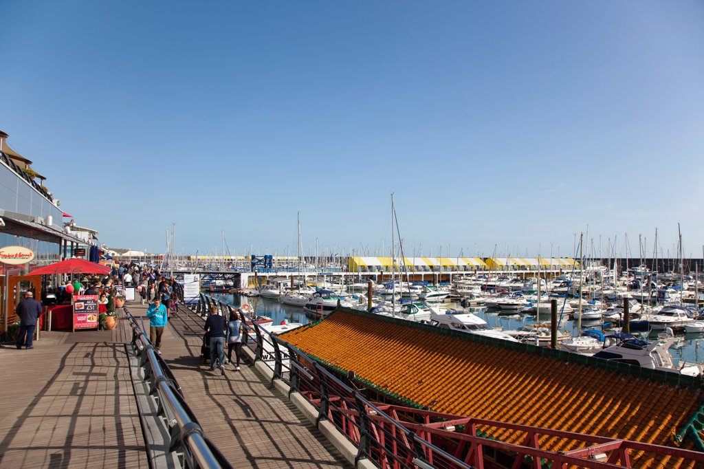 Stock Photo: 1850-46389 England, East Sussex, Brighton, View along the boardwalk over boats moored in the Marina.