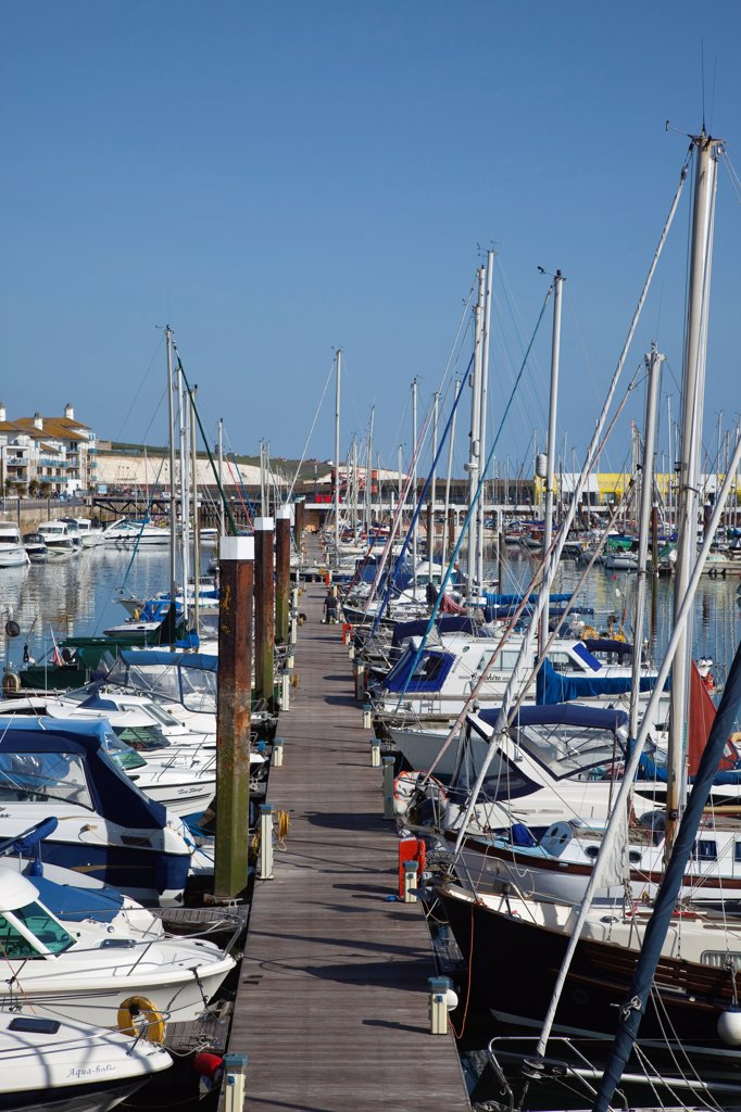 Stock Photo: 1850-46397 England, East Sussex, Brighton, view over boats moored in the Marina with apartment buildings behind.