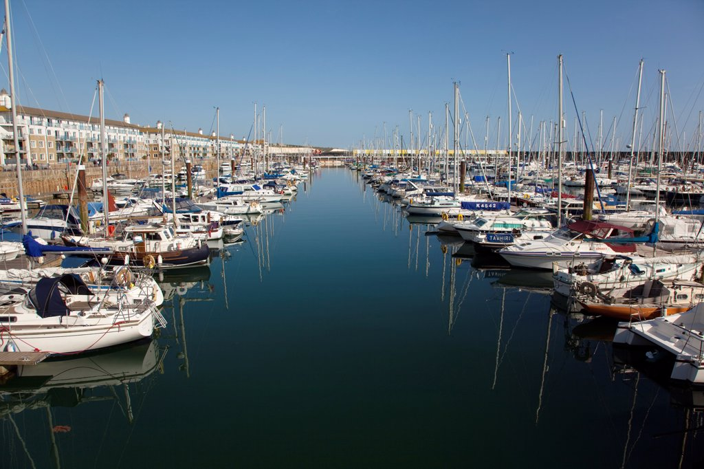 Stock Photo: 1850-46398 England, East Sussex, Brighton, view over boats moored in the Marina with apartment buildings behind.