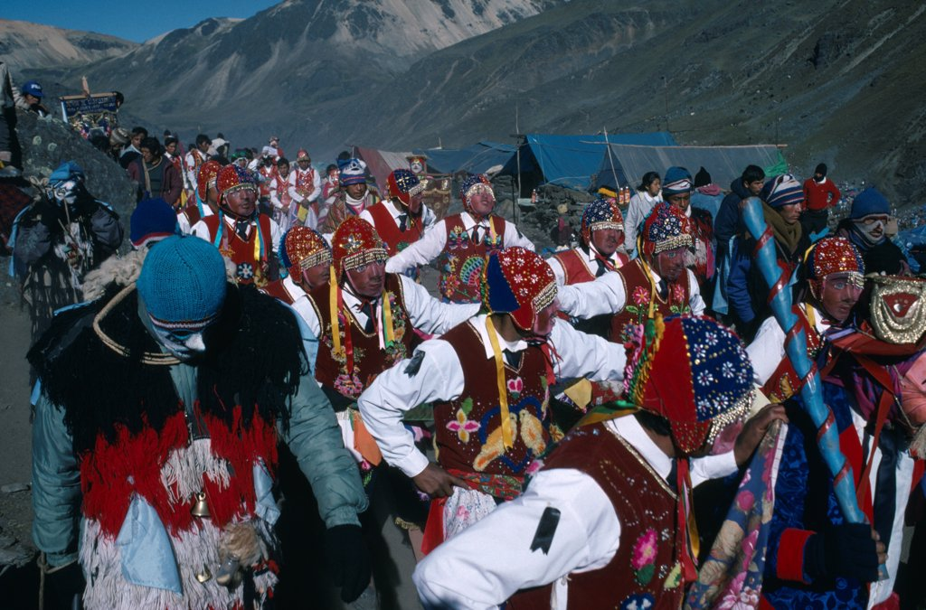 Stock Photo: 1850-46515 Peru, Cusco, Vilcanota Mountains, Ice Festival of Qoyllur Riti. Pre Columbian in origin but of Christian significance today with pilgrimage to place of Christs appearance. Procession of masked dancers.