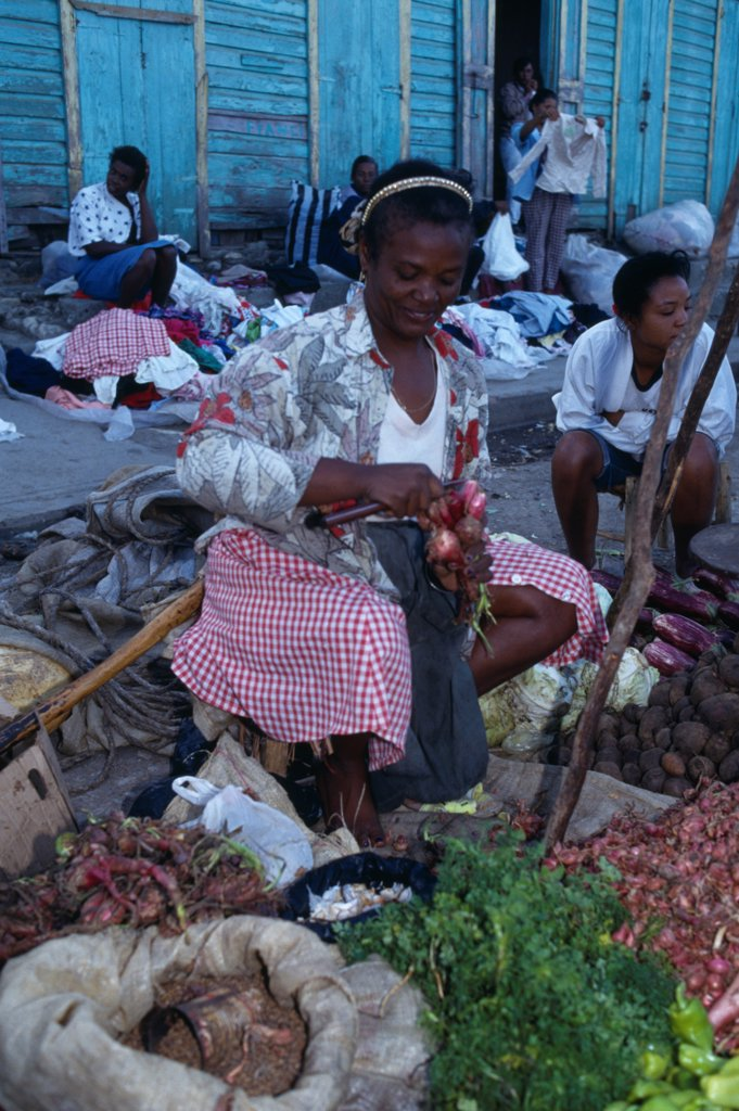 Stock Photo: 1850-46551 Dominican Republic, Markets, Vegetable stall holder in market.