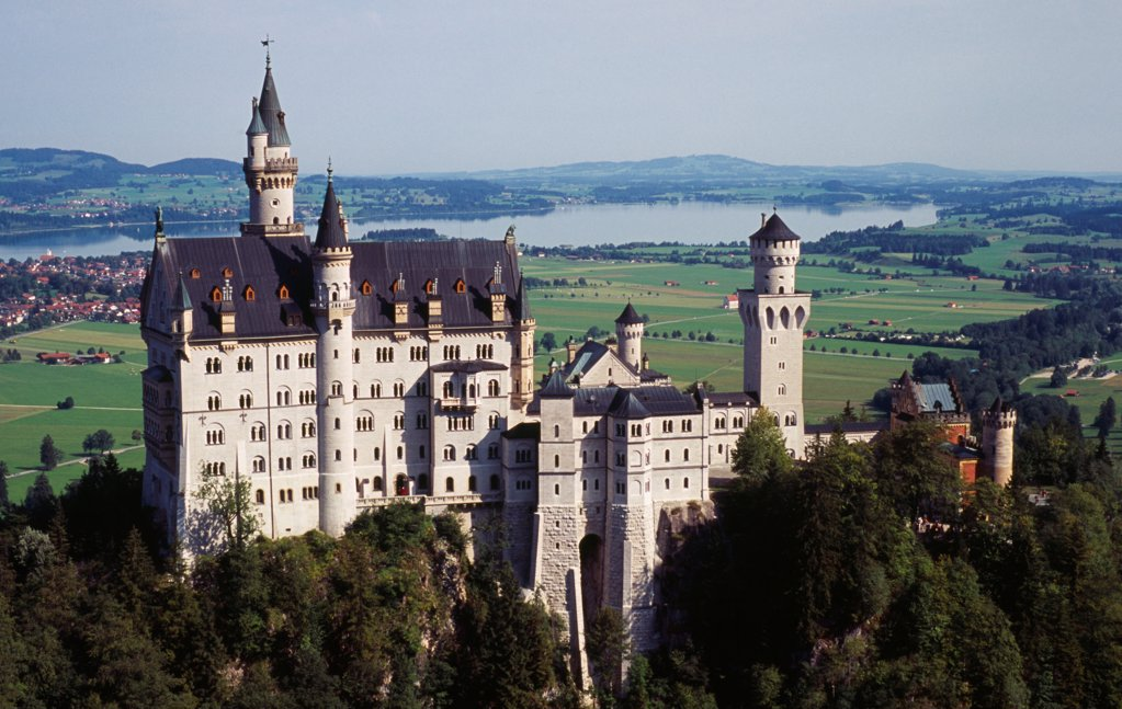 Stock Photo: 1850-46988 Germany, Bayern, Allgau, Fussen. Schloss Neuschwanstein Castle with Forggensee Lake in the backround. Built in 1869-86 for King Ludwig II.