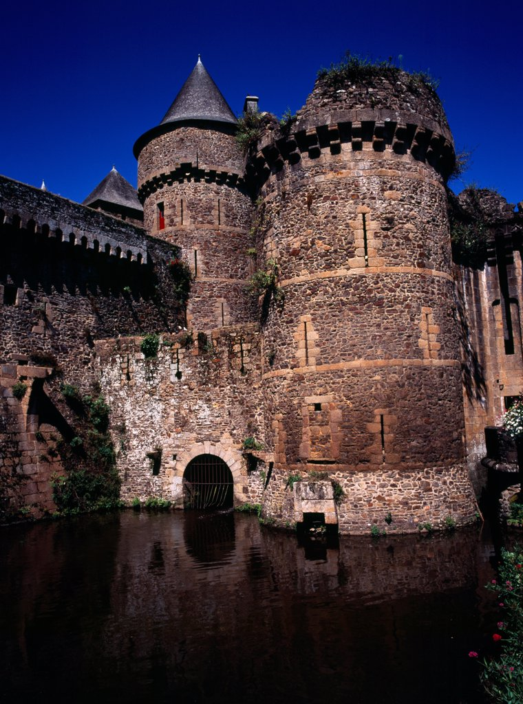 Stock Photo: 1850-47057 France, Bretagne, Ille-et-Vilaine, Fougeres. Defensive walls and towers of the chateau dating from 11th to 15th century rising from moat.