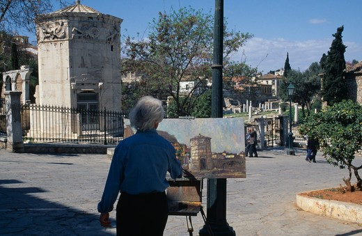 Stock Photo: 1850-4729 Greece,  , Athens, Temple Of The Winds With Artist Standing At Easel Painting In The Square