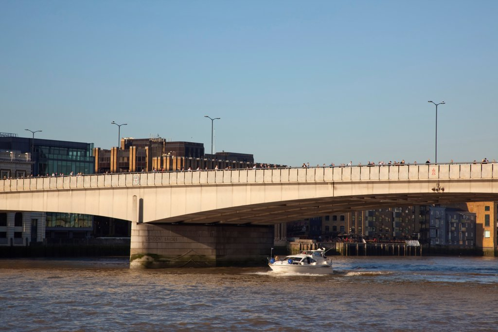 Stock Photo: 1850-47599 England, London, Southwark southbank early morning commuters crossing London Bridge to get to the City Financial District with moto cruiser passing underneath.