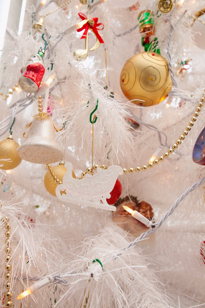Stock Photo: 1850-47747 Festivals, Religious, Christmas, Detail of tree decorated with lights tinsel and various baubles.