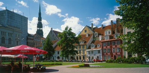 Latvia, Riga, City Centre Square With Outdoor Cafe In The Foreground : Stock Photo