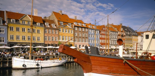 Stock Photo: 1850-4898 Denmark,  , Copenhagen, Boats On Nyhavn Canal With Pavement Cafes And Waterside Buildings Behind.