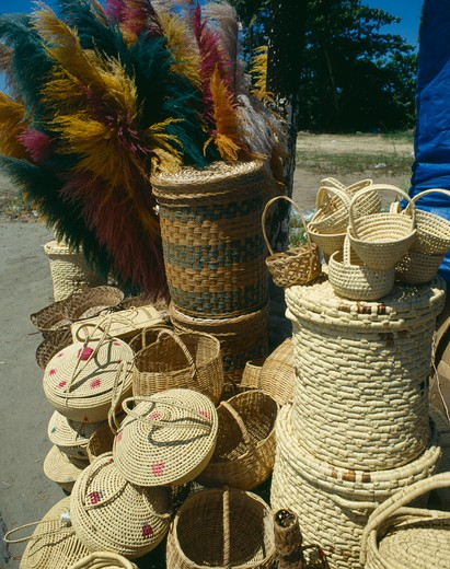 Stock Photo: 1850-5044 West Indies , Puerto Rico, San Juan, Display Of Wicker Baskets And Coloured Pampas Grasses
