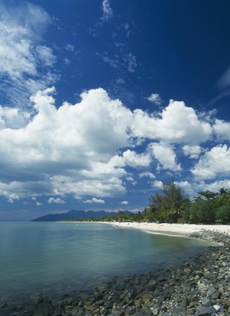 Stock Photo: 1850-5510 Malaysia, Langkawi, Kedah, Pantai Cenang Beach Looking Towards Gunung Mat Cincang With A Stoney Beach In The Foreground