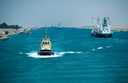 Stock Photo: 1850-596 Egypt, Suez Canal, Looking Down Canal With Tug Approaching And Ships Moving Away