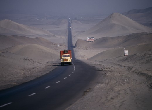 Peru, Transport, Traffic On Pan-American Highway Through Coastal Desert. : Stock Photo