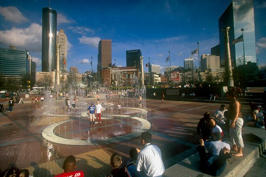 Usa, Georgia, Atlanta, 'Centennial Olympic Park.  Visitors Around Paved Area With Fountains, City Skyline Behind.' : Stock Photo
