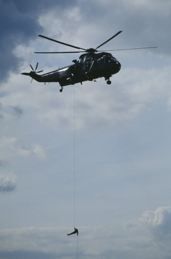 Transport, Air, Helicopter, Soldier Absailing From Sea King Helicopter : Stock Photo
