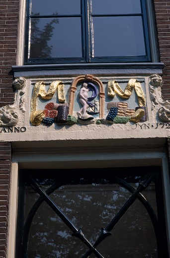 Stock Photo: 1850-7770 Holland, Noord, Amsterdam, Close Up Detail Of A Wall Tablet Used Before House Numbers Were Added
